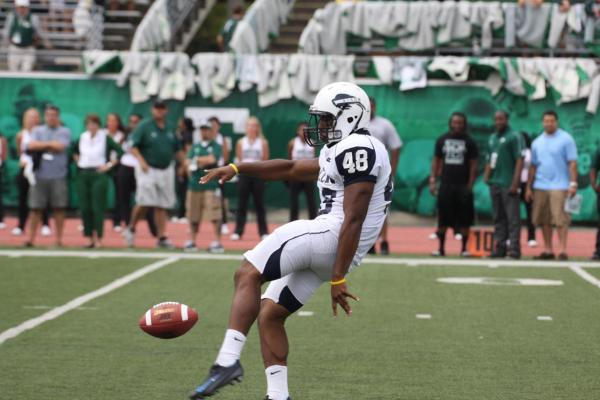 #48 Bryan Jackson punts the football for Howard, in a game at EMU.