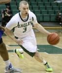 Austin Harper charges the basket